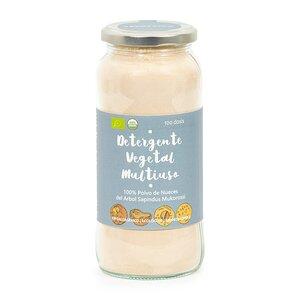 bote de cristal con detergente natural en polvo de color beige en el interior y etiqueta azul grisacea con nombre del producto